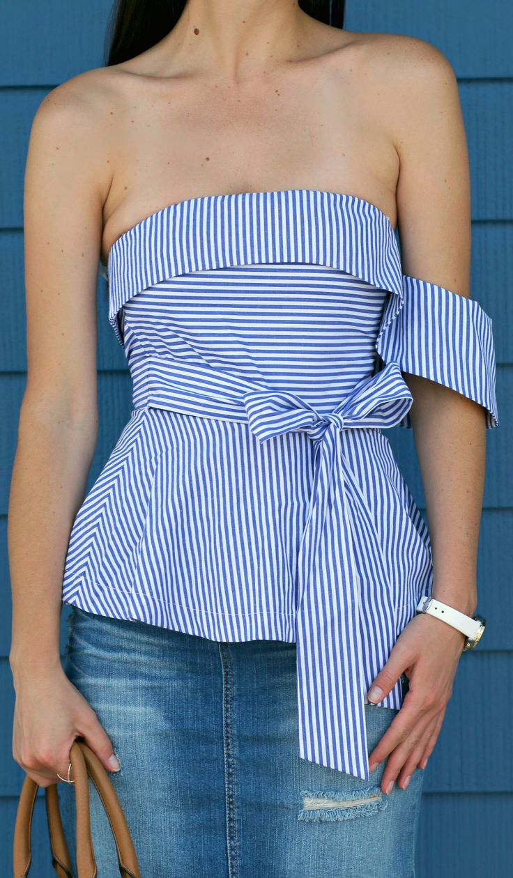 Blue seersucker one shoulder peplum top from J.O.A. with a distressed Target Style denim skirt, cognac Tory Burch bag, white Michele watch, and nude LC Lauren Conrad heels. Classic and casual spring outfit inspiration!