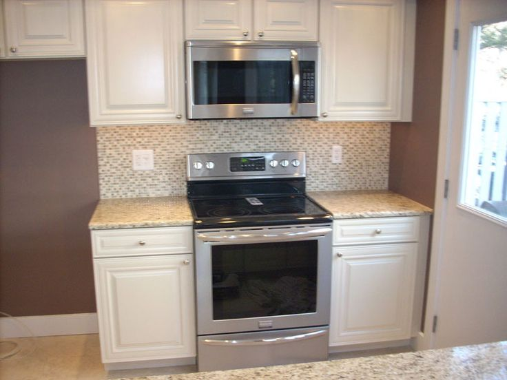 1000 Images About Homes Featuring Our Cabinets On Pinterest Cherry Kitchen Giallo Ornamental