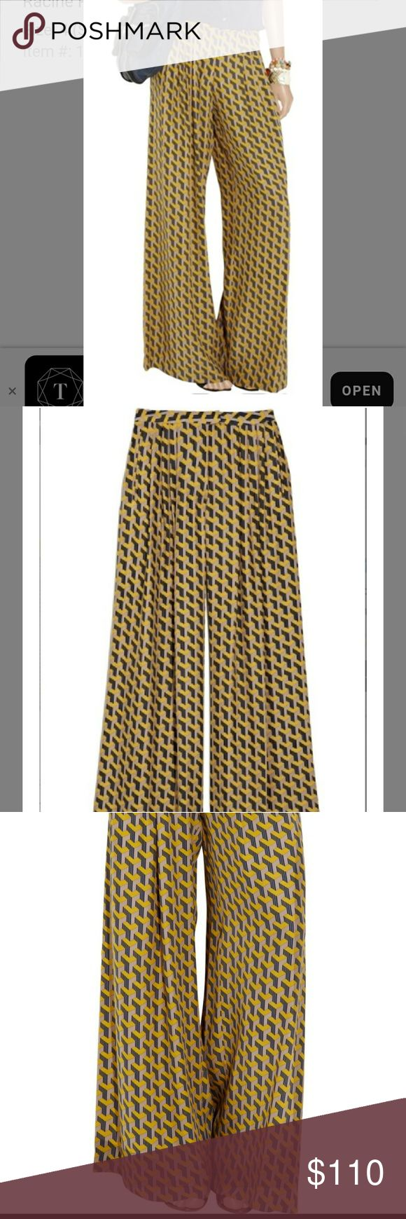 """Rag & Bone racine printed wide leg silk pants Beautiful chevron geometric print on these wide leg 100%silk pants in a sz 0. They features a zip button fly and side pockets. They measure  14"""" straight across the waist  11"""" rise  24/25"""" across the hips  33"""" inseam  14"""" straight across the leg opening  They also features flat besom pockets in the back and are in mint condition. rag & bone Pants Wide Leg"""
