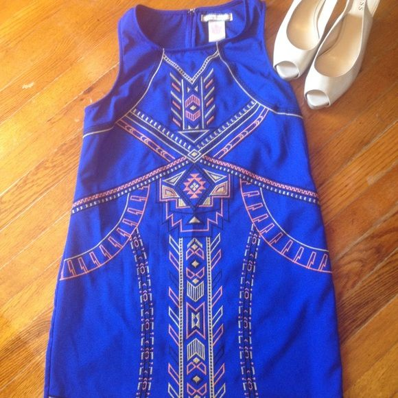 NWOT Stunning Embroidered Aztec Cocktail Dress Unbelievable gorgeous embroidered blue Aztec designed cocktail dress. This dress is certain to get all of the compliments at your spring evening events! The detail in the embroidery is phenomenal! Flying Tomato Dresses