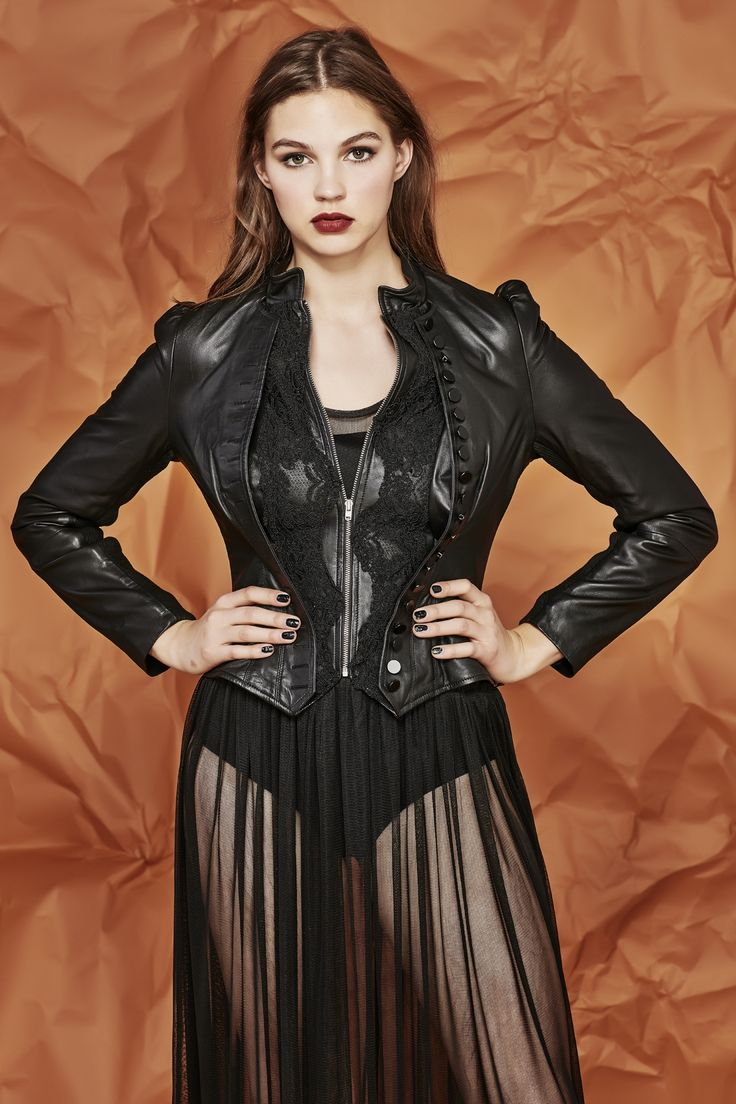 This Victorian style leather jacket creates the most flattering and feminine silhouette. With a dramatic fit and flare waist and subtle round collar it transcends into a lace inset front which is lined with a myriad of delicate buttons. The full length sleeves also feature subtle gathered shoulders. Zip front fastening. Pre Fall 2017 Size & Fit: Model is 177cm tall Model wears a NZ 8/ NZ S/ EU 36/ US 4 Wash Guide: Dryclean only. Select a high quality leather drycleaner...