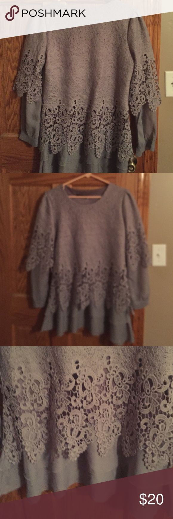 Gray lace with sheer sleeves blouse. Lace outer and sheer sleeves and flounce. Oriental company ( see pics). Says XXL but fits like an XL. New without tags Tops Blouses