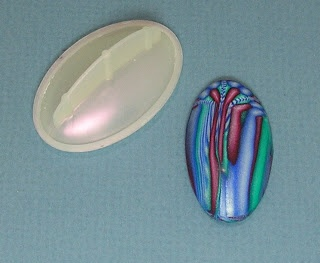 it's the protective cap off her stick deodorant and it works perfectly as a cabochon mold.