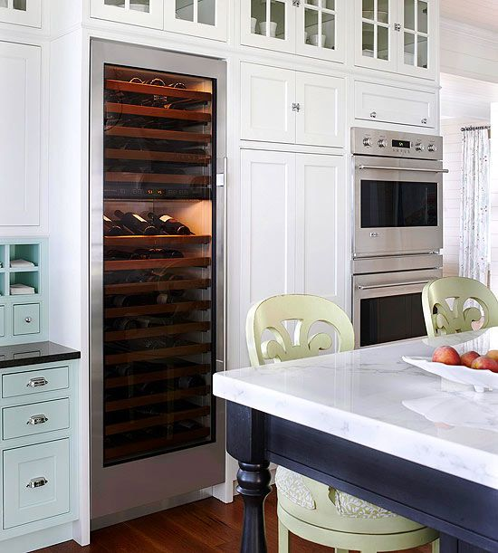 Love the wine cooler, double oven and upper cabinets!
