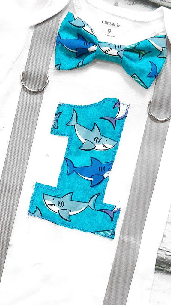 Baby boy first birthday Shark theme Bow Tie and number 1 bodysuit. Great for a birthday party, going out to the park or lounging around the house. IMPORTANT! Please read our store announcements for current processing time and our new shipping policy. Please DO NOT leave questions