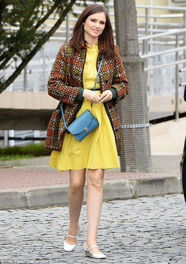 Looking Polished: Sophie Ellis-Bextor, 37, was mellow in a yellow autumnal dress and jack...