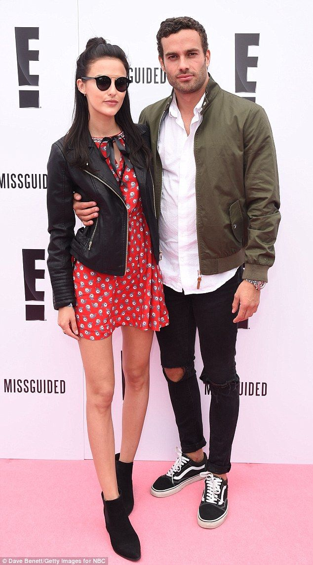Loved-up: Made In Chelsea couple Lucy Watson and James Dunmore cosied up in the E! Lounge...