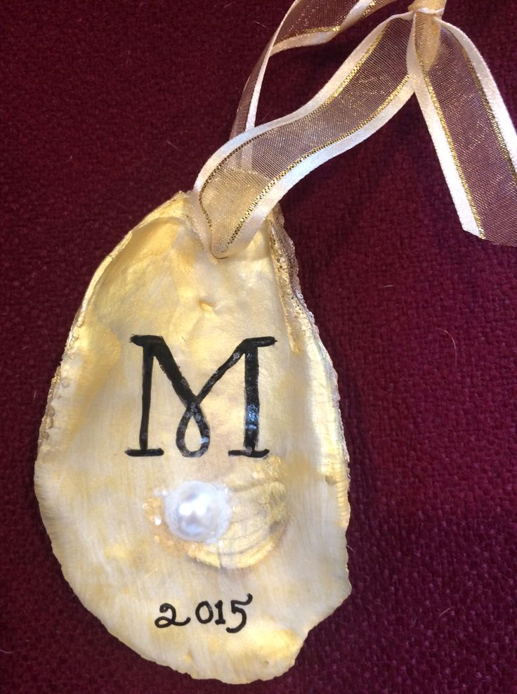 """hand-painted oyster shell ornaments, embellished with a faux """"pearl""""--gold or silver (date optional)."""