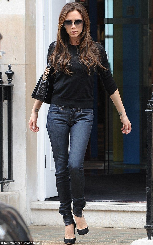 Super skinny: Victoria Beckham wears a pair of tight fitting jeans, black sweater and vertiginous heels as she shops in London on Thursday