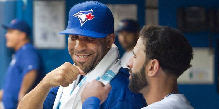 New Blue Jays pitcher David Price has a moment with right-fielder Jose Bautista during the first game after Price arrived in Toronto, 31 July 2015.