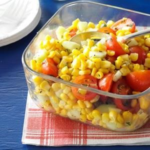 Cherry Tomato Corn Salad Recipe -Brighten a picnic lunch or backyard barbecue with this cheerful, fresh-tasting salad. If you use want to use sweet corn off the cob, saute the corn for 5 minutes in a skillet before adding to the salad. —Taste of Home Test Kitchen