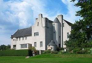 This building is referred to as the Hill House. It is located in Helensburgh, Scotland . Its architect was Charles Rennie Mackintosh. He   built it for the publisher Walter Blackie. Charles Rennie Mackintosh designed most of the interior rooms, furniture .In 1982 the house was donated to the National Trust for Scotland. They continue to maintain it and manage visitors.
