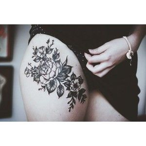 Thigh flower tattoo