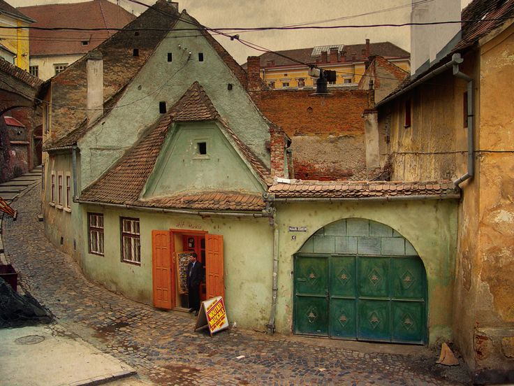 Sibiu Photo by Oleg Tishkovets via. Very painterly photograph.