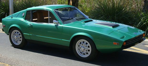 1971 Saab Sonett III. These were quirky and fun little cars. A rare sight today...