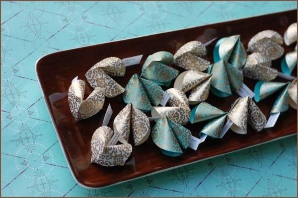 DIY Fortune Cookie Favors  http://www.oncewed.com/7578/diy-wedding/favors/diy-fortune-cookie-favors/?currentPage=2