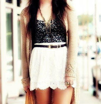 Black sparkle top with white lace skirt.
