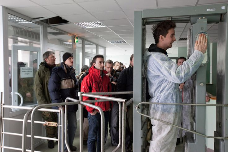 [CNPP, Chernobyl Exclusion Zone, Ukraine, 2011] During a tour of the Exclusion Zone, tourists check themselves for contamination at the entrance gates to the cafeteria for the workers of the Chernobyl Nuclear Power Plant in Pripyat. © Gerd Ludwig / National Geographic Creative / National Geographic Magazine