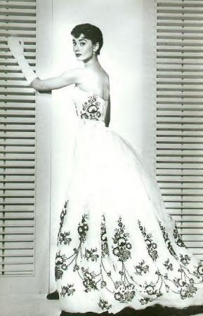 audrey hepburn in a givenchy wedding dress with black lace embellishments