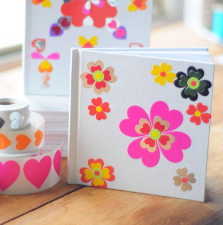 Cover a blank journal, canvas, or plain greeting card with heart stickers as a cool Valentine's Day Gift! A great craft for kids of any age!