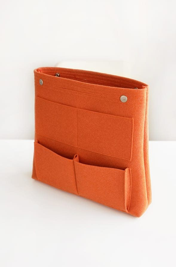 The *Long Felt Purse Organizer* is a super functional and classy organizer! It is designed to help tidy up bags and purses and is ideal for use in larger tote bags. It features 8 pockets on the outside and 9 additional pockets inside. The bottom 4...