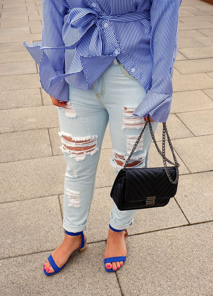 How to make ripped jeans look dressy.  Ripped jeans, blue sandals, distressed jeans, striped shirt, casual outfit