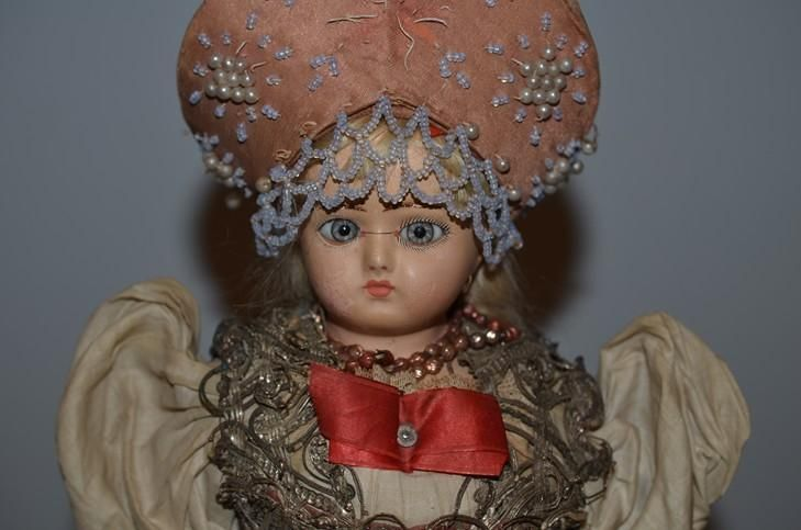 Here is a wonderful Papier Mache doll with glass eyes. The doll is 16 1/2 tall NOT including her fancy Hat with hand beaded work. The doll is just