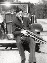 Clyde [born: March 9, 1909] With Guns, Including Krag-Jorgensen He Traded For