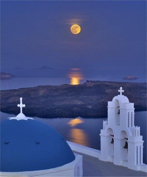 Blue night and golden moon in Santorini island, Greece