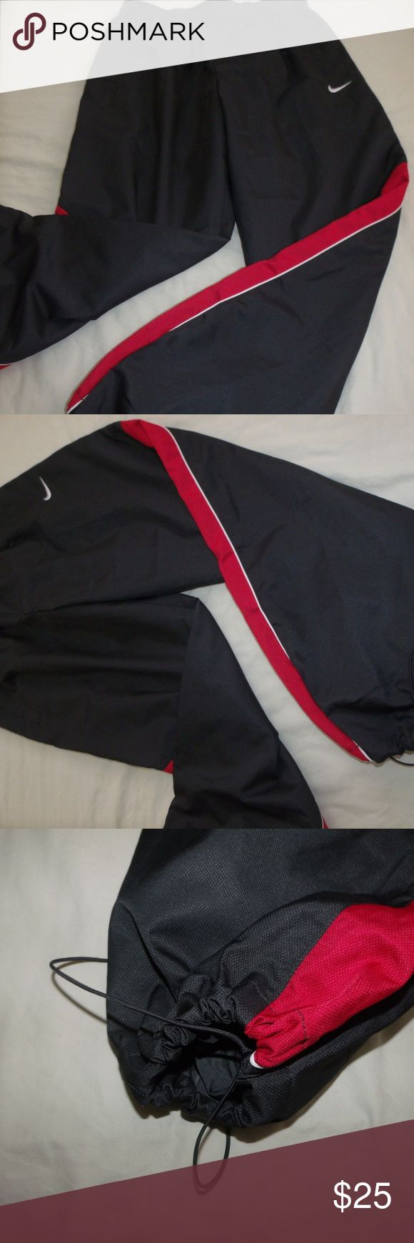 NWOT Nike Lined Joggers Mens Nike runner Mesh Lined Pants Size XL Drawstring Closure Bottom Elastic and drawstring waist Dark Grey with Red Panel New without tags Nike Pants Sweatpants & Joggers