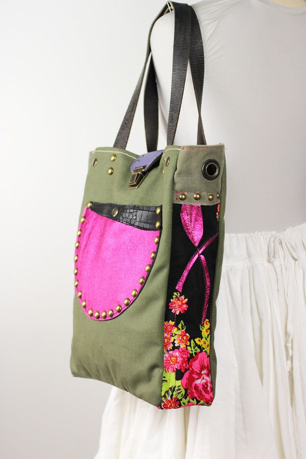 Unique medium sized tote bag handcrafted with upcycled canvas from a vintage military tent. Combined with metallic Silver leather and floral design vintage fabric. The front features a...