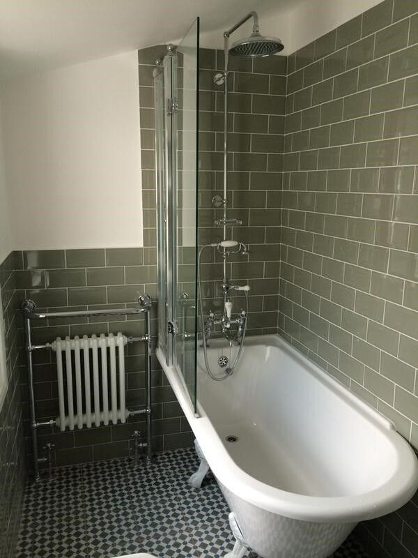 Customers stunning Burlington Hampton Freestanding Shower bath with Burlington Shower Screen with access panel. Burlington Exposed Bath Shower Mixer with riser and head. The customer has used period brick style tiles and mosaic floor tiles for the perfect finish. www.victorianbathrooms4u.com