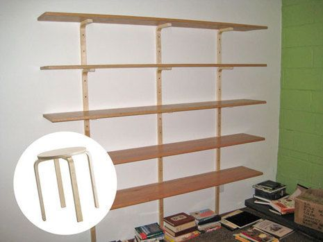 Shelf brackets from the hardware store run about $7-12 a piece, and you have your choice of twisty faux-Tuscan or industrial drab. This Ikea hack from Apartment Therapy gets your four 'brackets' for twelve dollars, with a much finer bent plywood motif.