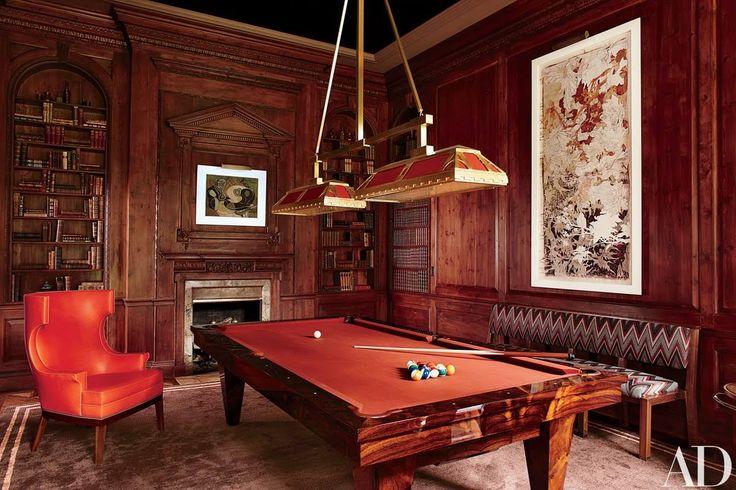 A pool table by Blatt Billiards an Art Deco light fixture