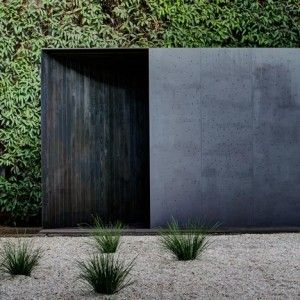 Crescent House, a charred timber pavilion with deceptively curved walls in the garden of the Sherman Contemporary Art Foundation in Paddington, Sydney by Andrew Burns