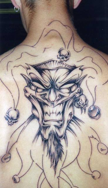 Grey Ink Jester Tattoo On Man Back Body