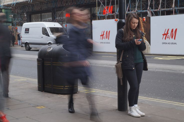 On the tripod, I zoomed in so that I could capture the model clearly. I like this photograph as you can still see the features on the person that is walking past, face. I think that the slow shutter speed captured the people in this shot well as they look distorted.