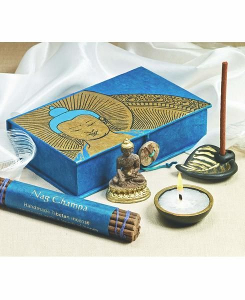 Buddha altar box is the consummate item for practice, either at home or on the go. Contains a Buddha figurine, Khata (greeting scarf), votive, Nag Champa incense, and a gilded ceramic bodhi leaf incense burner.