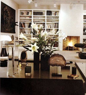 Chic living space  Lovely built-ins: shelves and cabinets. Very modern fireplace with track lighting! Glossy black lacquer table desk! White black living room! black white gold brown living room space colors.
