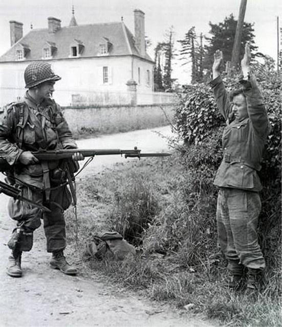 Prisoner of war: German soldier surrending to US Paratrooper, WWII