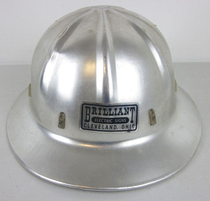 "Decal inside hat reads ""Apex Safety Hats, Boyer-Campbell Co. both front and back have a decal for ""Brilliant Electric Signs, Cleveland, OH"". 