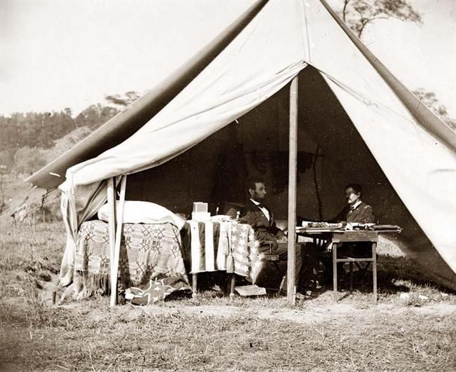 Unusual full view image of President Lincoln visiting General McClellan in the general's tent at the Battle of Antietam. Photograph by A. Gardner 1862. Note the captured Confederate flag on the ground.  *s*