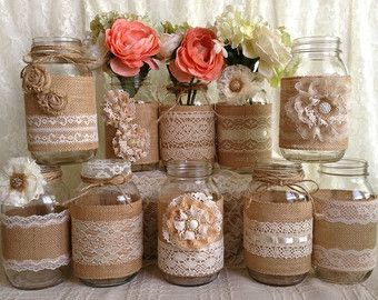 5 burlap and ivory lace covered mason jar vases with flowers, wedding, bridal shower, baby shower decor.  I made this adorable vases with natural color burlap and ivory color laces, ivory flower, rhinestone buttons. jars size: 32 OZ quart 3.78 x 7.0 After i receive payment, please EXPECT approximately 2 to 3 WEEKS for your item to be made and prepared for shipment.  I also make any color and size vases you want, just let me know what you are looking for.  Mason jars are perfect for fresh…
