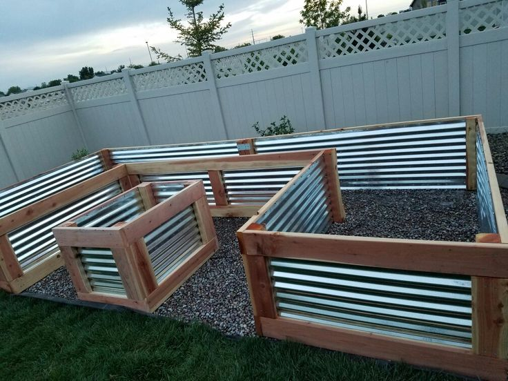 Used redwood and galvanized sheet metal. Measures 4 ft W x 8 ft x 16 ft x 27 in …