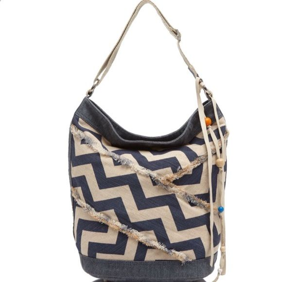 """TOMS Journey Indigo Chevron Bucket Shoulder Bag Chevron print puts a graphic spin on this slouchy, vintage-vibe shoulder bag in cotton canvas from do-gooding accessories label TOMS and cute beaded tassel. Cotton canvas with adjustable shoulder strap. Magnetic top closure and fabric lined. Two interior slip pockets, interior zip pocket Approx measures 14.75""""L x 8""""W x 14.75""""H; 16"""" strap drop. Brand new with tags! TOMS Bags Shoulder Bags"""