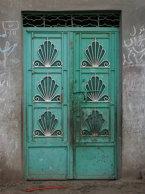 Egyptian village of Beni Mansur.  Aqua doors with shell ironwork