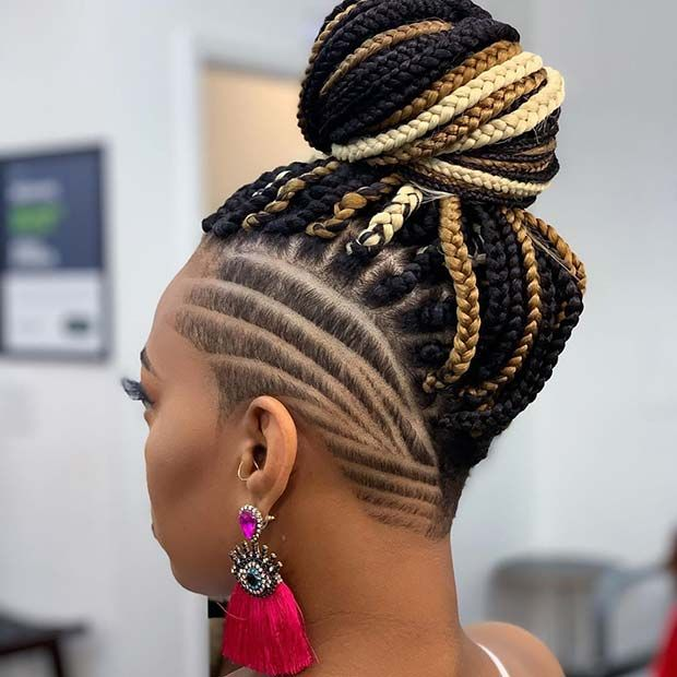 Edgy Shaved Hair With A Braided Bun In 2020 Shaved Side Hairstyles Braids With Shaved Sides Box Braids Hairstyles