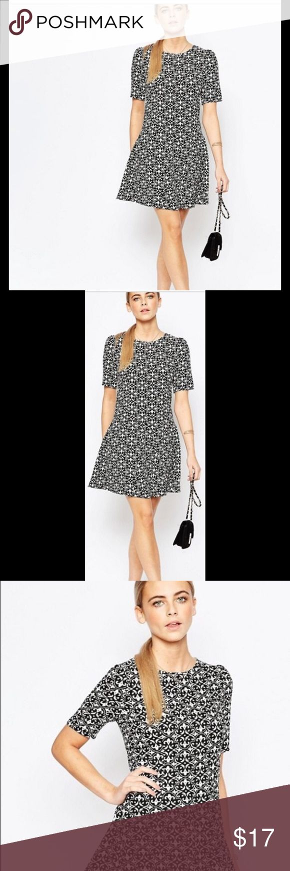 "ASOS Fashion Union Flippy Dress in Mono Print US 6 Never worn, Only tried on, Flawless ASOS Dress...Fashion Union 'Flippy' Dress in Mono Print. NOW, Completely out of stock on ASOS.com Short Sleeve, back Zipper, Very Flattering above-knee Dress in a Black & White Damask look pattern! I thicker-woven 100% Polyester. US S/6 Perfect for a Luncheon or any day wear! Length is 34"" Bust, across: 19"" with minimal ""give"" Fabric is a substantial poly. not at all stretchy. ASOS Fashion Union Dresses…"
