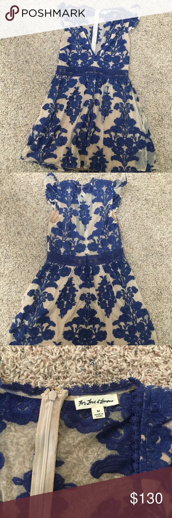 For Love and Lemons Dress This mid-thigh, v-neck dress is in a royal blue/cream color, size medium, and even has discreet pockets! Was originally $200, only worn once, and is great for a school dance or a night out! For Love And Lemons Dresses Mini