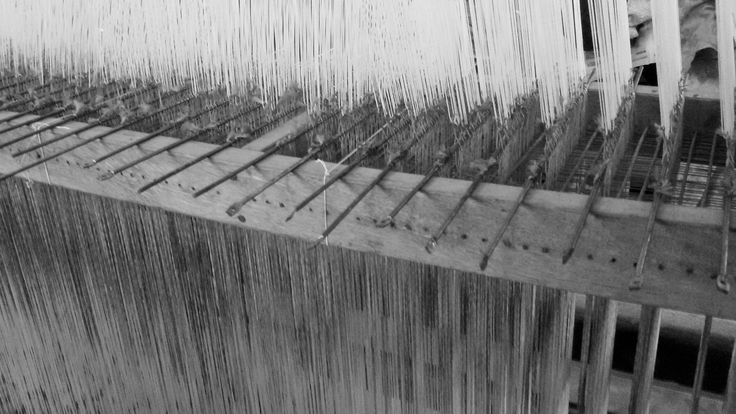 Our Jacquard Loom. The Jacquard loom is a mechanical loom, invented by Joseph Marie Jacquard in 1801, which simplifies the process of manufacturing textiles with complex patterns such as brocade, damask and matelasse. The loom is controlled by punched cards with punched holes, each row of which corresponds to one row of the design. Multiple rows of holes are punched on each card and the many cards that compose the design of the textile are strung together in order. #MadeInNepal…
